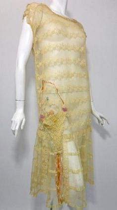 "Charming ecru netting and lace sheer dress with lace ""hanging"" basket at right hip adorned with silk chiffon rosettes in pastel hues and coordinating silk ribbon streamers. Vintage 20s Dresses, 1920s Dress, Vintage Outfits, Vintage Clothing, Flapper Dresses, 20s Fashion, Vintage Fashion, Flapper Fashion, Flapper Era"