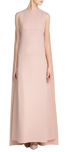 A true statement piece in soft pink, Valentino's floor-sweeping silk gown is fluid in its streamlined cut, but made instantly dramatic with a tonal cape at the back. Keep accessories to a minimum to let it leave its impression #Stylebop