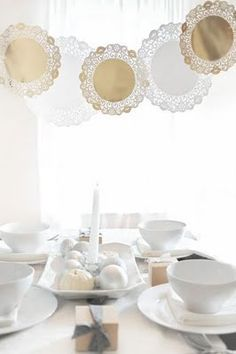 Hanging paper doillies over a tablescape will create a perfect upcycled chandelier