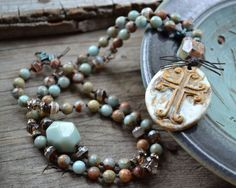 Earthy Bohemian Gypsy Necklace Stoneware cross pendant Impression jasper layering Rustic pale aqua blue cream brown Hand knotted gemstones    I love