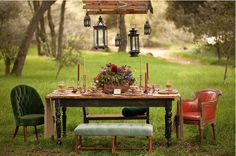 Shabby Chic outdoor dining....love the suspended lanterns