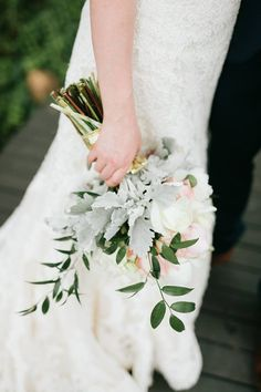 Ivory and blush wedding bouquet arranged with Italian ruscus with a soft crown of dusty miller by Mulberry Weddings. Photographed by Justen Clay Photography.