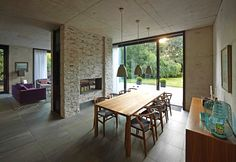 Dining Area / Suburban Home with Concrete Structure that is Exposed Throughout the Interior building concrete structure exposed interior