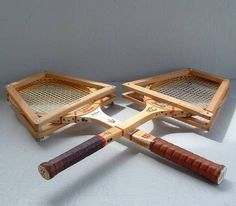 Wooden tennis rackets with wooden covers. You had to screw them tightly so the rackets wouldn't warp.