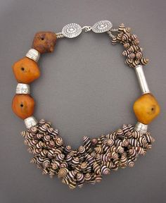 by Anna Holland | A fantastic necklace combining antique 'African' Amber beads from Mauritania, antique Moroccan Zebra Shells { These cute little shells are traditionally strung with coral and amazonite and are unique to Berber jewelry} and silver beads | SOLD