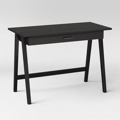 Maintain your modern style with the Basic Desk from Project 62™. This writing desk has one drawer for storing writing materials and other office supplies and keeping the tabletop clutter-free. The narrow style is perfect in smaller spaces to make the most of the room you have.<br><br>1962 was a big year. Modernist design hit its peak and moved into homes across the country. And in Minnesota, Target was born - with the revolutionary idea to celebrate design for all. Projec...