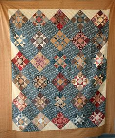 Civil War Homefront Quilt by Betsy Chutchian for Lone Star House of Quilts.   Reproduction of an antique quilt.  2009