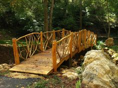 Rustic Wooden Footbridge at Acadia - Powdersville, South Carolina, US--this would look great over the creek behind the log house! Pond Bridge, Garden Bridge, Garden Structures, Garden Paths, Garden Pond, Rustic Gardens, Outdoor Gardens, Sloped Backyard, Backyard Ideas