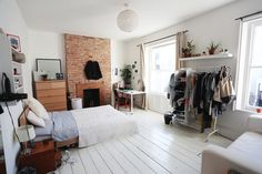 Amazingly cozy all white Scandinavian studio apartment with exposed brick accent | small space interior inspiration