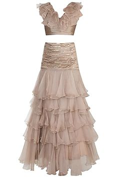 Featuring a light brown ruffled lehenga skirt in organza and taffeta base with ruffled layers including cutdana sequins pearls and bead embroidery. It is paired with a matching blouse. Lehenga Skirt, Lehnga Dress, Lehenga Blouse, Banarasi Lehenga, Indian Fashion Designers, Indian Designer Wear, Indian Attire, Indian Wear, Indian Wedding Outfits