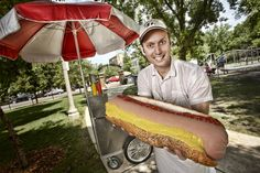 Gorilla Tango Novelty Meats CEO Dan Abbate poses with the largest commercially available hot dog, which weighs 7 pounds. Chicago-based Gorilla Tango sells the whopping wieners for $40.