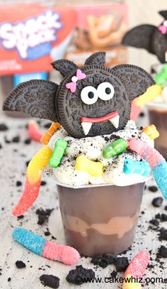 Use Oreos and store bought candies to transform pudding cups into MISS. DRACULA PUDDING CUPS for Halloween. From cakewhiz.com {Ad}