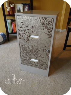 Use beautiful wallpaper to cover the front of an old filing cabinet.  Wonderful!