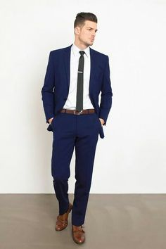 Sometimes, a simple navy suit just works. It fits perfectly and never disappoints. Stylish Engagement Party Attire for the Groom Blue Suit Men, Navy Blue Suit, Navy Suit Brown Shoes, Prom Suit Blue, Blue Prom Suits For Guys, Men's Blue Suits, Blue Fitted Suit, Navy Suits Groomsmen, Guys Suits