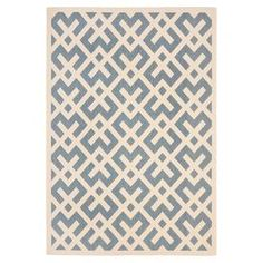 Loomed indoor/outdoor rug in blue with a fretwork motif.  Product: RugConstruction Material: PolypropyleneColor: Cream and blueFeatures: Suitable for indoor and outdoor use Note: Please be aware that actual colors may vary from those shown on your screen. Accent rugs may also not show the entire pattern that the corresponding area rugs have.