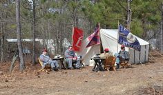 STAFF PHOTO BY CINDY KUBOVIC  Volunteers re-enacted the Battle of Aiken Saturday by setting up camp for the night in the woods.