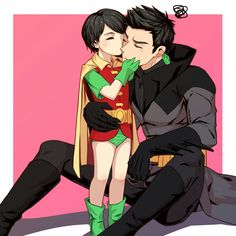 (read this I will hit you in the feels) Just imagine this is Damian as batman then his son is kissing him NAWWWWW