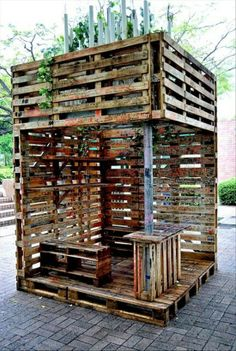 Outdoor lounge with upper patio made from pallets.
