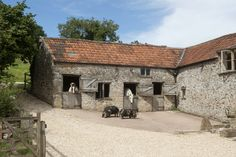 The original 19th Century stable yard, complete with three loose boxes. Sorry the Kune Kune pigs and the ponies don't come with the stables!
