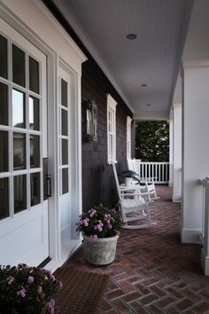 OMG, this is kinda like Houzz, with uploaded pics.  I love this porch, with dark gray and white...