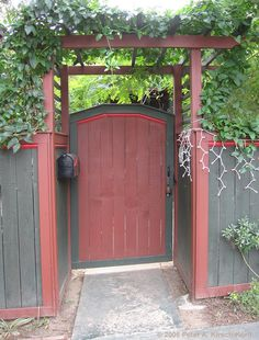love how the gate is offset with the the fence. Entry Gate with Arbor & Fence - Los Angeles, California red grey two tone gate pergola privacy fence