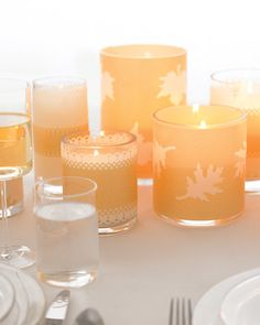 The how-to for this centerpiece couldn't be easier—just layer pieces of punched vellum around glass votives. It works with both round and square containers, and the candles can be arranged on tables of all shapes. When lit, the punched areas filter light beautifully and add an aura of romance.   Punches used: Nos. 6, 14, by Martha Stewart Crafts; Effervescence Border Punch, Diamond Border Punch, by Fiskars, widgetsupply.com.