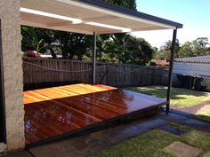timber deck over boxspan steel deck frame and steel frame awning over