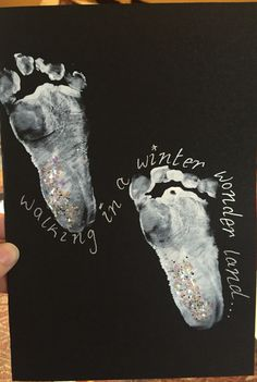 Winter wonderland. Baby footprint Christmas card