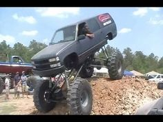 Huge Suburban hydroplanes, catches the wall, then snaps left front hub while making a pass at The Mud Farm in Sour Lake - Be sure to check us out on. Mudding Trucks, Big Wheel, Big Trucks, Rats, Offroad, Chevy, Toyota, Jeep, Monster Trucks