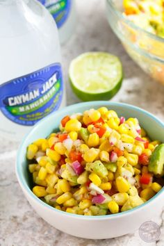 Corn and avocado salsa paired with refreshing Cayman Jack Margarita is the perfect combination for your next summer getaway! #sponsored #CraftedbytheJourney