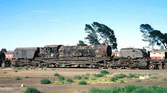 A Garratt type steam locomotive of SAR (South African Railways) class GO with number 2592 taken out of service at De Aar loco depot.