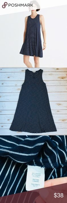 """Madewell High Point Tank Dress in Chevron Stripe Madewell High Point Tank dress in navy/white stripe. EUC. Perfect closet staple. Wear with a jean jacket and converse for a casual cool look. Size XS  PRODUCT DETAILS Made of supersoft jersey with a touch of stretch, this swingy tank dress is ridiculously versatile in easy chevron stripes. Just add shoes et voilà—the two-minute outfit.  Nonwaisted. Falls 34 1/4"""" from high point of shoulder. Viscose/poly/cotton. Hand wash. Import. Item G6473…"""
