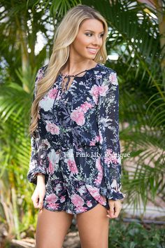 It doesn't get much better than floral rompers, and this one is no exception! Features long sleeves, a peephole in the back, v-neck, pockets on each side, and tie around the top!