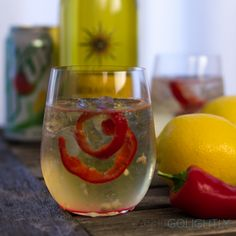 Zesty wine spritzer with white wine, peppers, and lemon