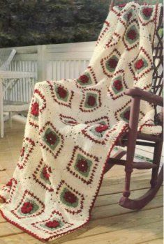 PA858 Vintage Rose Afghan Pattern.   A pretty palette of rose embellished squares creates a lovely effect on this pleasing afghan. Puffy popcorns form flowers on the squares which are bordered in coordinating shades and whip stitched together.