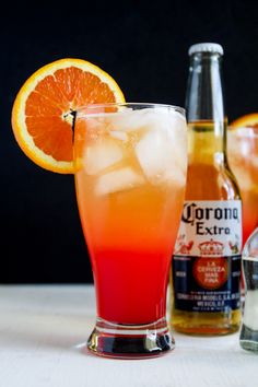 Corona Sunrise Cocktail - Tequila, Corona, orange juice and grenadine make this delicious cocktails. Perfect for Cinco de Mayo.