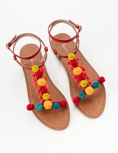 It's a (not entirely scientific) fact that you can't have a bad day when you're wearing pompoms, so we've added a whole load to these lively sandals. They're crafted from leather in a T-bar design, with ankle straps for extra comfort.