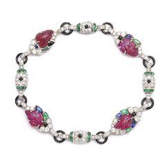Art Deco Tutti Fruiti Bracelet - Sapphire, diamond, emerald, and carved ruby bracelet, set in platinum with black enamel links.  American, ca.1930. (=)