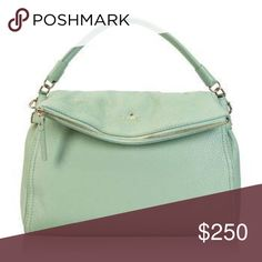 """KATE SPADE NY Cobble Hill Little Minka Crossbody Pre-loved. Mint color. Pebbled leather. Fold-over style.  Convert satchel w/removable & adjustable crossbody strap w/22"""" drop max. Handle drop is 4"""". Zip pocket flap w/leather zip pull and magnetic closure. Inner zip & slip pockets inside. Has a very small ink mark on the inside flap (as seen on pic), like 1 cm long.  Also lining shows some pen marks & stains from normal wear. No rips/tears. All zippers work well. Inc dust bag. There is also a…"""