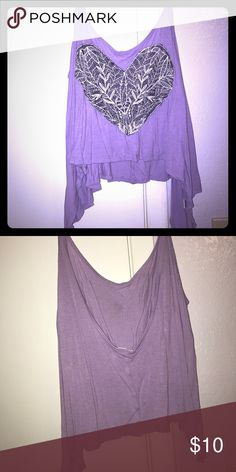 Purple crop top Size small purple crop top with cute lace heart on the front. The back scoops low and the sides hang a little longer. Check out my closet! Tops Crop Tops