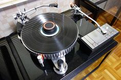This Micro-Seiki DDX-1000 Turntable accommodates 3 tonearms on one platter, making it easy to compare different cartridges & stylii on the same source material, or to maintain stereo, mono and 78 rpm stylus assemblies without having to swap cartridges.