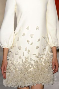 Ivory dress with bishop sleeves and 3D applique flower petals - textured embellishments; haute couture