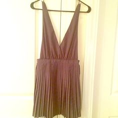 Low-cut Grey Pleated Dress - Used Once! As seen in photos this dress fits tight right at the waist with a very low cut and pleated skirt. I've always layered the dress over a top but it can be worn on its own as a very revealing and sexy short dress. Size small but borders on XS with side zip closure. Dress does not stretch. Forever 21 Dresses
