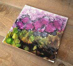 Iris-loving cooks will enjoy having this decorative ceramic tile trivet at hand. Its a colorful way to protect countertops! Hand painted with alcohol inks on repurposed ceramic tile. Sealed and cured with clear high heat spray and backed with rubber feet to protect your surfaces.