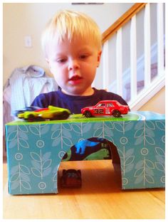 Toddler fun with a tissue box tunnel bridge and cars!
