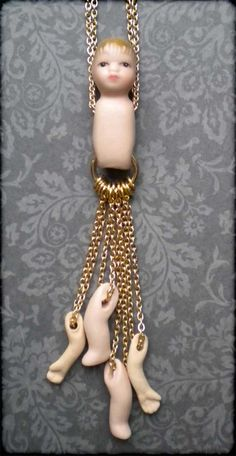 Broken Doll Necklace Gold Plated chain by GirlFromJupiter on Etsy, £24.50