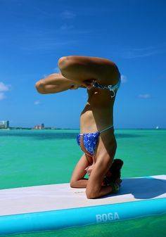 Lotus Headstand on A Paddle Board