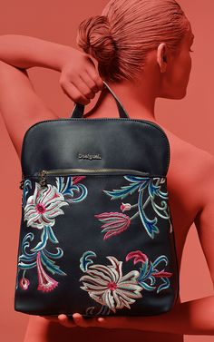 43e521b14e6 Desigual Blue synthetic leather backpack with floral embroidery on the  front in blue and fuchsia hues