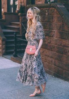 A flirty floral dress, velvet flats, and a matching bag.