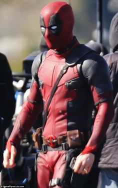 Suited and booted: Both Ryan and his counter-part donned the clinging black and red suit t. Black And Red Suit, Deadpool 2016, Deadpool Costume, Stunt Doubles, Wade Wilson, Ryan Reynolds, On Set, Actors, Costumes